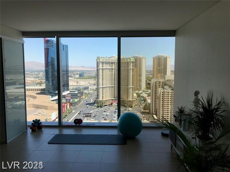Stunning 1 bedroom unit features high ceilings and expansive floor to ceiling picture windows w/ window coverings throughout highlighting the spectacular views from every angle. Kitchen with solid surface counters, stainless steel appliances, custom cabinets, glass backsplash and breakfast bar. Wake up to views of the picturesque Las Vegas strip in a spacious bedroom with spa-style bathroom featuring a modern bathtub and separate stand-up shower. With unequaled views of Las Vegas atop each tower, the amenities floor features a roof-top infinity-edge pool, hot tub, sun deck and bar for outdoor entertaining, rec room, and a fitness center