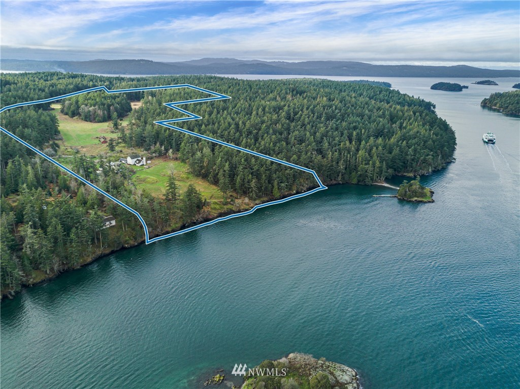 With an echo of yesteryear, this magical northwest facing 112 acre property in 4 tax parcels with 770' of medium bank waterfront is simply perfect for creating a true island retreat. Perched above Broken Point on Shaw Island, enjoying mesmerizing views over Harney Channel to West Sound, Pole Pass, Crane Island, and beyond to the Cascade Mountains, this enchanting, private, quiet estate consists of an inspirational 2492 sf, 4 bedroom/2 bath home, historic barns inclusive of saw mill, farm sheds with equipment, peaceful pond, orchard, and raised garden beds with partial fencing. Embrace the potential. Be drawn to the luminous light and tranquil mood. In that moment, time stops. It will touch your heart and change your life.