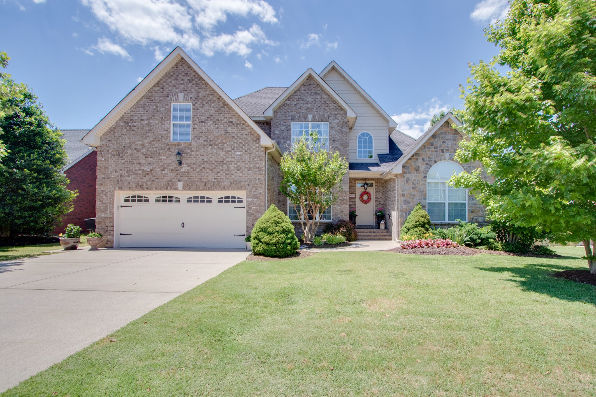 Upscale all brick home convenient to I-24 & 840. Soaring Ceilings. Light filled. Huge Master BR & Bath. Perfect layout has 2nd BR on main floor perfect for in-laws; nursery; office; etc. whatever you need! 2 BR and Bonus up, or 3 BR up!  2 new Trane HVACs in 2018; new granite kitchen countertop & tile backsplash with new dishwasher; gorgeous crown molding & millwork; backyard deck & fence; maximum 3 persons at each showing; please wear mask; Open House Sunday, May 31.  Don't miss this one!