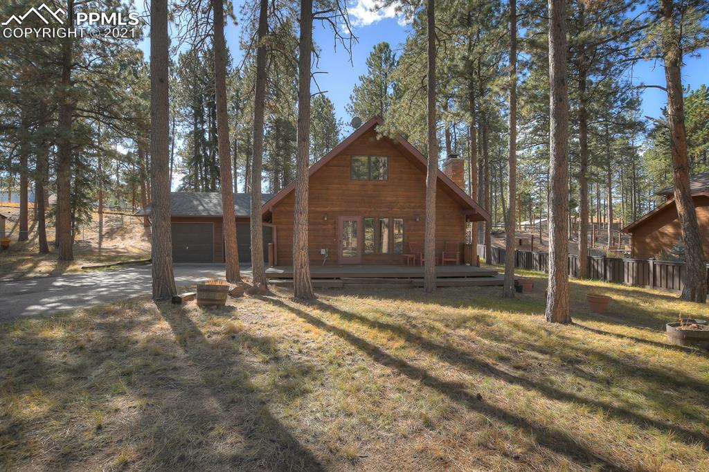 Your home above the clouds! Wonderful Woodland Park! Welcome to your three-bedroom, two-bath, with two-car attached garage. Mature magnificent trees, and a useable large yard for your wildlife viewing pleasure. Gourmet kitchen is complemented by granite countertops, tile floor, all appliances included, and new Cherry Cabinets. Dining room and living room open up to a comfortable and cozy wood fireplace. Perfect for family fun, and board games. Main level offers 2 bedrooms, a full bath, and laundry. Washer and dryer are included. The upper level boasts a family room, office or craft room for your work at home needs. Master bedroom is large and lovely! Forced Air and Natural Gas, Teller 1 water, and city sewer, with high speed internet capabilities. Close to hiking, biking, shopping, public safety, and schools. Mountain retreat living with city like amenities. About a thirty-minute relaxing drive to military bases, airport, and Colorado Springs. Come home to Woodland Park.