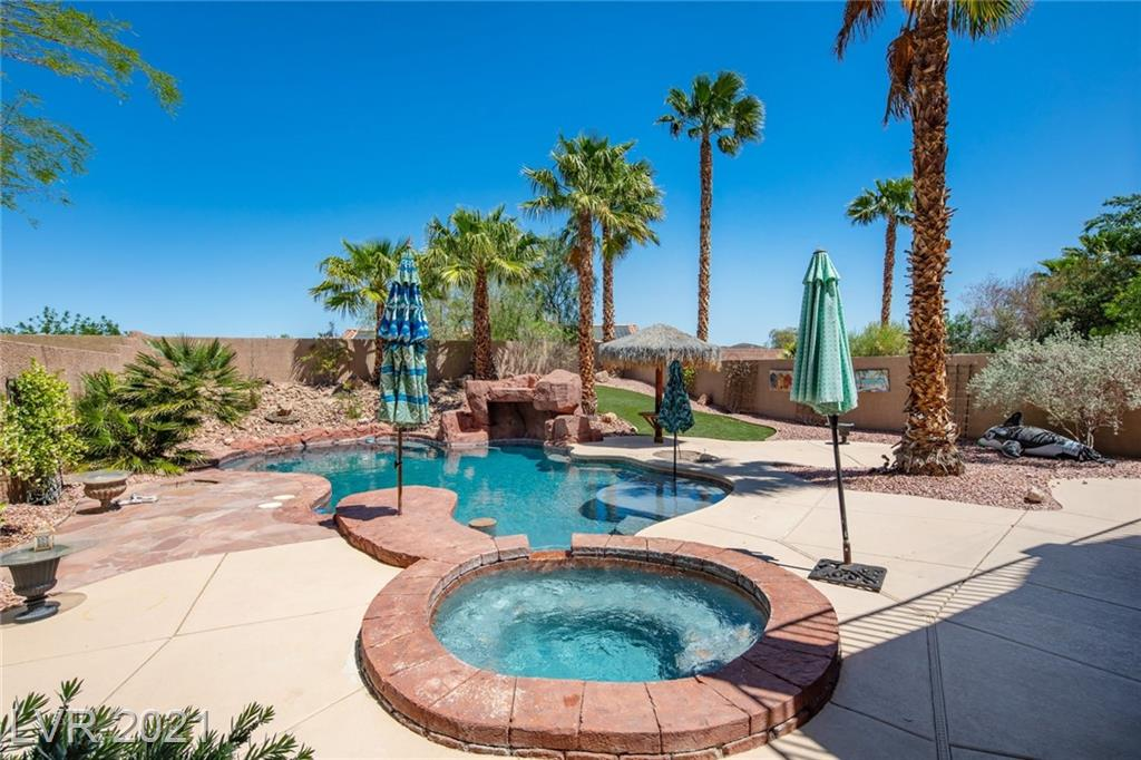COVENTRY AT ANTHEM COMMUNITY, GREAT ROOM FLOORPLAN, WOOD FLRS, STYLISH ISLAND KITCHEN, SLEEK CABINETRY, GRANITE COUNTERS, STAINLESS STEEL APPLS, SPACIOUS PANTRY. DESIGNED FOR THE MODERN WINE ENTHUSIAST, THIS GORGEOUS IRON DOOR ENTRY TO WINE CELLAR THAT OFFERS PLENTY OF SPACE FOR THE REFINED COLLECTOR! ENTERTAINING HERE IS A BREEZE! RESORT STYLE POOL/SPA PLUS PULAPA & PALM TREES,  BUILT IN BBQ OUTDOOR KITCHEN ISLAND, COVERED PATIO, EXTRA DEEP REAR YARD!