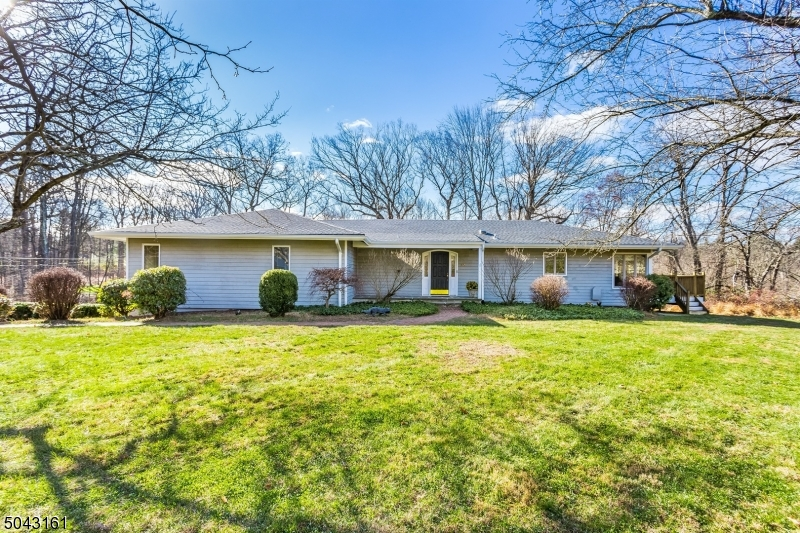 Just what you have been waiting for: Beautifully updated expanded Ranch located on 2 acres of property. The updates have just been completed, now the home is ready for you! Brand new Kitchen with Quartzite Taj Mahal countertops, built in pantry, new cabinets, flooring & SS appliances. Living/Dining rm combo w/ tons of natural light. Hardwood flooring. Each bedroom has a full walk in closet. Newly installed Jack/Jill bathroom between bedroom 2 & 3. Ground level has plenty of storage space w/ built ins, cedar closet & wine cellar. Ground floor also has the third full bath. The home has a unique floor plan that can fit many different uses: in laws, gym, rec room, bedroom 3 can be a perfect den. The options are endless and all yours to make. Come on in, unpack and enjoy a home that is in move in condition.