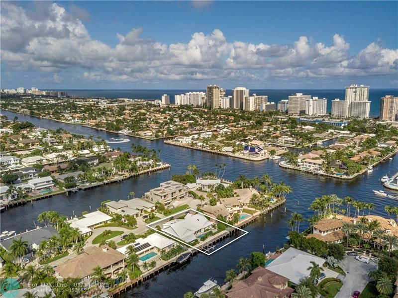Unlimited potential with waterfront views in walking distance to the Coral Ridge Country Club.  100' of south-facing water frontage, only 2 from the point, on the most prime street in Coral Ridge Country Club. This residence - with a modern layout, 10' and higher ceilings, grand entry foyer and a newer roof - is ready to be customized by a new owner. 4 bedrooms - including 2 master suites, office, 4.5 bathrooms, vaulted great room ceiling, and an enormous chef's kitchen that is open to an additional living room and dining room. Outside, a covered patio with built-in grill overlooks the pool, spa, and dock with direct Intracoastal views and a 2016 high-speed 4-motor 25,000 lb boat lift.  Sq ft from BCPA, believed accurate.