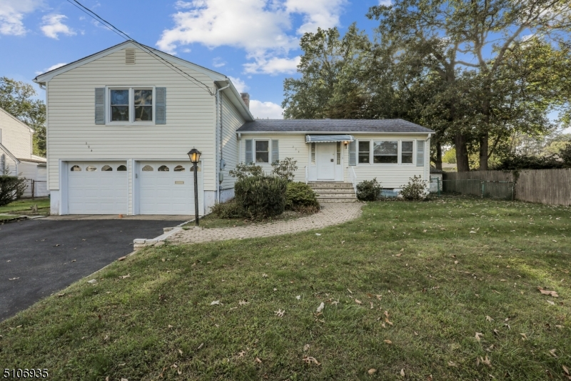 GREAT LOCATION - Less than a mile from Houses of Worship, schools, downtown shopping/restaurants and bus to NYC. This very unique split level home offers spacious living; with large rooms and lots of them! Besides a large Family Room with a wood burning fireplace and access to the garage and to the backyard, there's also a Den open to the Kitchen. Off the Den is a 3-season completely finished interior Sunroom with another access to the backyard. There are endless options for large open floor plan designs. The Powder Room has been updated. The bedrooms are also larger than usual.  Other features include: Hardwood floors under all 1st and 2nd floor carpets, porcelain tile in the Kitchen, Stainless Steel Oven and Refrigerator, an abundance of hallway closets, LED lighting, 2-car oversized garage with newer exterior doors, fenced-in yard with 2 patios, Hot Water Heater that is only 4 years young, a full bathroom in the basement, sump pump, french drains and two attics - one with an easy entry for tons of storage. The possibilities for this house are limitless!   Note: Springfield offers full day Kindergarten.