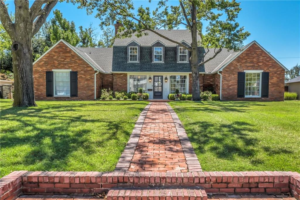 This beautiful  Raymond Carter home has all the details and charm.  Walking up to this house from the street feels elegant.   When  you open the front door, you look straight to the backyard through a gorgeous bay window.  Master suite on the main level featuring vaulted ceilings, His and Her walk in closets.  Master bathroom is fresh, clean and crisp with beautiful marble, double vanities, make up area, soaker tub, large open shower.  Another spacious bedroom on the main level with en-suite bathroom. Kitchen is beautiful and features marble counter tops, wonderful cabinetry, wet bar, built in drink fridge and china cabinet. New window treatments and electrical updates. Upstairs there are two bedrooms and two full bathrooms.  The storage is abundant and the house is move in ready.