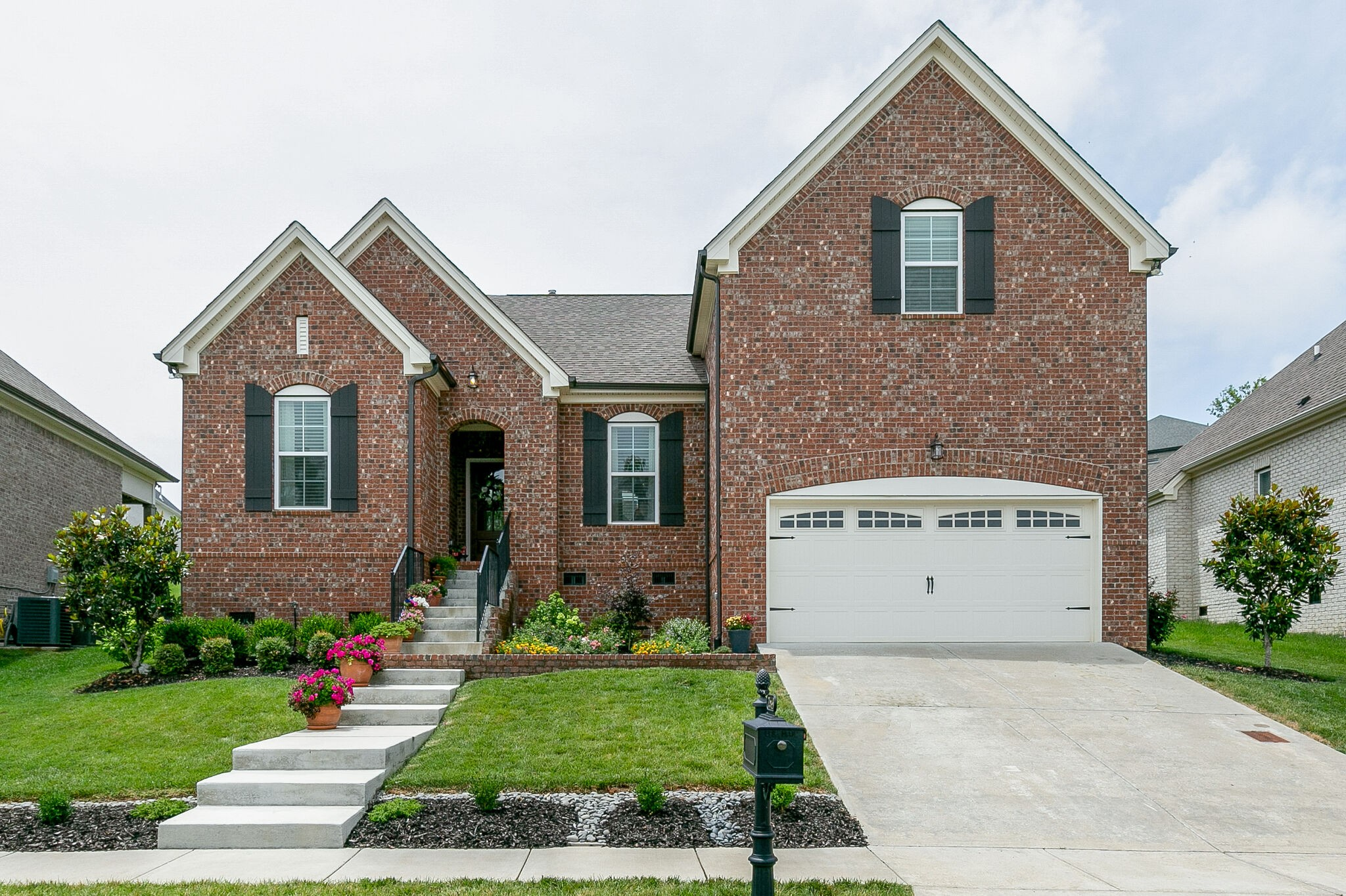 This amazing home is move-in ready & better than new! 3 or 4BR w/2 on main level. Tons of upgrades including custom lighting, custom roman shades, blinds, surround sound, extensive hardwoods, custom built-ins, vaulted ceilings, designer lighting & mirrors & gas fireplace. Kitchen w/ white cab, double ovens, 2 pantries, & wall treatments. Master bath w double vanities, walk thru shower, soaker tub, & walk in closet. New landscaping and screened porch. Hurry this won't last long. Virtual Tour