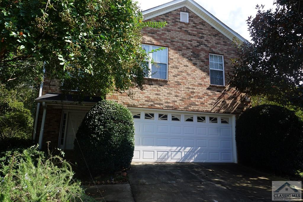 Prime location in this gated community makes 227 Covington Place the one you've been waiting for ! The Village at Jennings Mill has long been one of the more desirable low maintenance priced right neighborhoods in The Classic City and here's a chance to grab one of the very few basement homes that also has one of the better lots in the area. You'll love morning coffee on the back deck and then start your exercise routine by walking the award winning golf course which somebody else maintains for you :) Conveniently located by shopping, restaurants, UGA, downtown Athens, and hey Starbucks is right by the entrance ! Take a load off and choose the easy life at The Village at Jennings Mill and grab the unicorn with the finished basement space at 227 Covington Place. This one won't last !