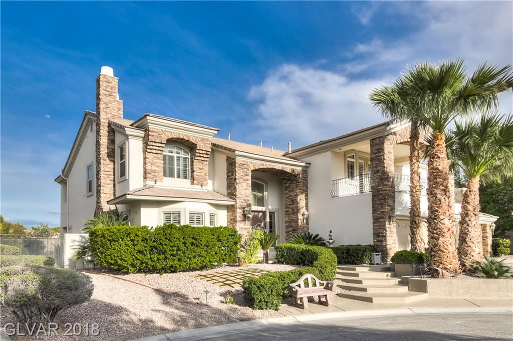 Gated, 1/2 acre lot w/4 car garage. Potential Boat/RV parking. Designer tile. Plantation Shutters. Chef's Kitchen w/ Granite Isl., double oven, 5 burner cook-top, Nook, & Walk in Pantry. Master w/sitting area, Fireplace & balcony. Deluxe Master Bath. Junior master w/ en-suite bathroom & bedroom and bath down. 2nd family room up w/ balcony & wet bar.  Landscaped Backyard w/ Built-in BBQ, Solar Heat Tropical Rock Pool w/slide Waterfall & Koi Pond.