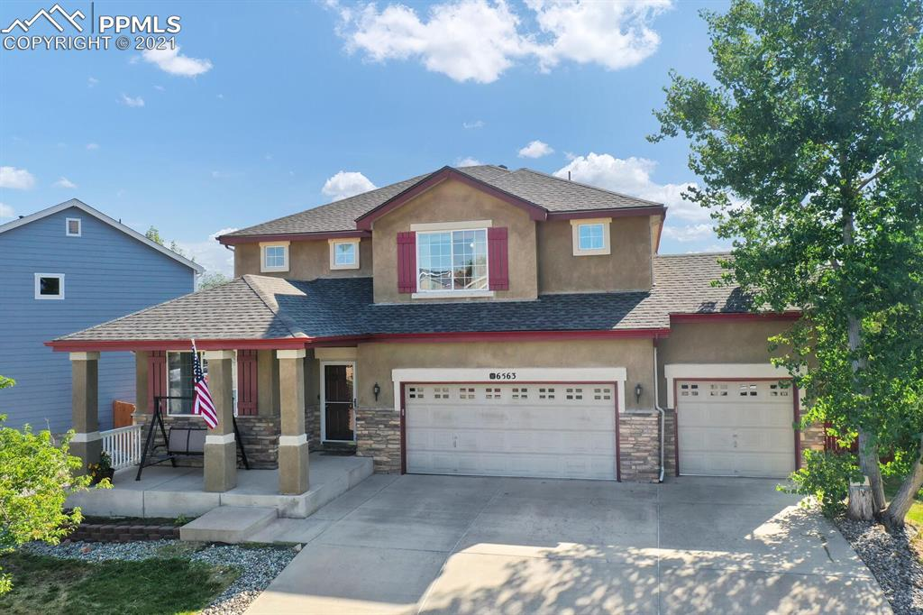 """Welcome Home!! You will be sure to fall in love with every inch of this immaculate home. This well maintained two story house is located in the highly desirable Cheyenne Ridge neighborhood (NO HOA) with easy access to Fort Carson and other military installations, shops, restaurants and more! As you enter the home you are greeted with soaring two-story ceilings, new wood floors, fresh paint and tons of natural light. The office is located at the front of the home for additional privacy and features wood floors and 9 foot ceilings. The kitchen is the heart of this home. With ample counter-top space for all your cooking needs, there are also 42"""" cabinets that allow for generous storage space. The wood floors continue in the kitchen and dining room. The main level also features a second family room to relax and watch Sunday Night Football! All 4 bedrooms are located on the upper level that has stunning views of below. The large master bedroom includes a HUGE walk-in closet and 5-piece master. Three more large bedrooms and a secondary bathroom with a double vanity finish out the second floor. The massive 5th bedroom featuring french doors finishes out the basement level with a second living room, a game/entertainment room including a wet bar! A full bathroom and additional storage are also included in the basement. The three car garage and large lot make this home absolutely perfect."""