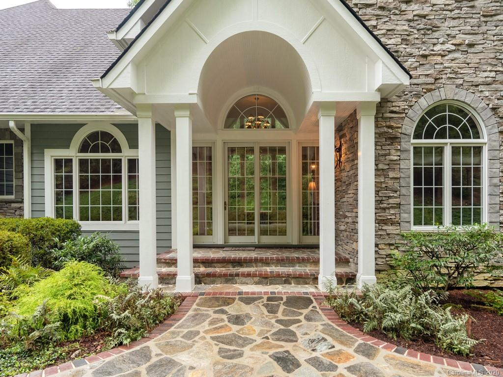 4 Car Garages in this extraordinary 3BR/3.5BA Kenmure home situated on 1.27 level, wooded acres. Open, bright floor plan w/ plenty of entertaining options. Impressive foyer, formal DR, cathedral ceiling LR w/ FP & graced w/ floor to ceiling wall of windows. Top-of-the-line kitchen/SS appliances, granite countertops, spacious keeping room w/ FP & access to covered deck overlooking small creek. Beautiful main-level master w/spacious closets & sitting area, majestic BA w/ jetted tub, & walk-in shower. Architectural features include cathedral ceiling, intricate custom trim, 10-ft ceilings & massive windows to enjoy abundant natural light. Private study could serve as home office or main level guest BR w/ full BA. Multiple decks for entertaining. Main-level 3 car garage w/ workshop + additional 4th garage w/ substantial basement/workshop & private drive ,whole house generator, 3 gas-forced heating systems. A short drive to the Flat Rock Playhouse, shopping/dining in Historic Hendersonville.