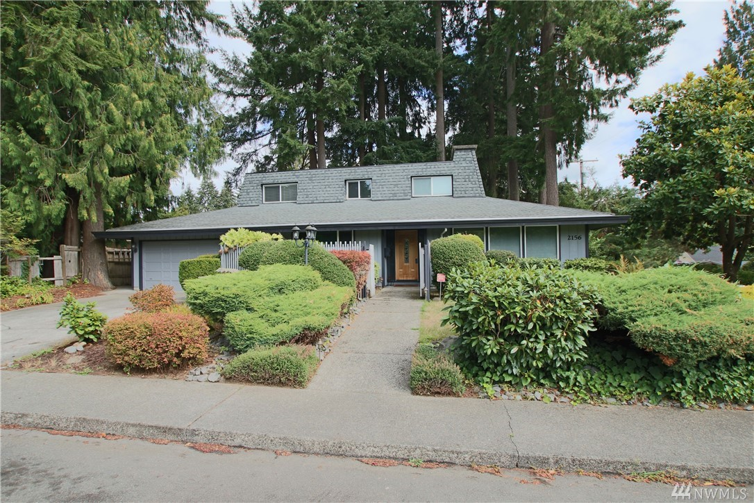 Rare Find & Impeccable Olympia location! Former Street of Dreams Mid Century Modern 4 BR 3.5 BA home w/covered patio & office centrally located on large corner lot in Woodcrest near Washington Middle School, Pioneer Elementary & Olympia HS. Features include tile master bedroom shower, walk in closet, vaulted ceilings, skylights, gas appliances, double ovens, heatpump w/ AC, mature beautiful landscaping, fenced yard, shed, hot tub, vinyl windows and 2 car garage with built-in cabinets / counter.