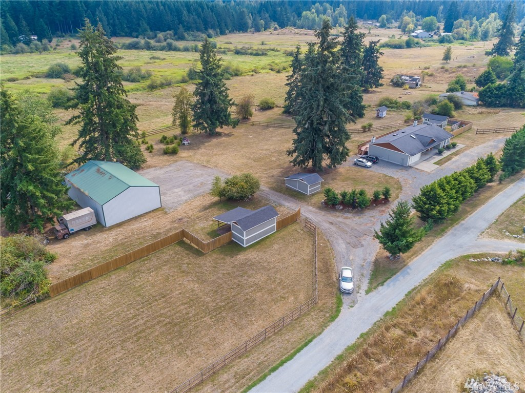 15+ acres in country setting with great Mtn View!  40x60 Detached Shop with tons of storage and parking along with multiple storage buildings! Great rambler with HUGE bedrooms, and bonus room!  Home sits above property overlooking the valley with a deck extending the entire back of home.  Private drive shared with 7 homes, all on large acreage/lots.  3 rail fencing for horses, dirt bike track in lower fields, home is ready for you!  Property does not disappoint! Home Warranty Incl.