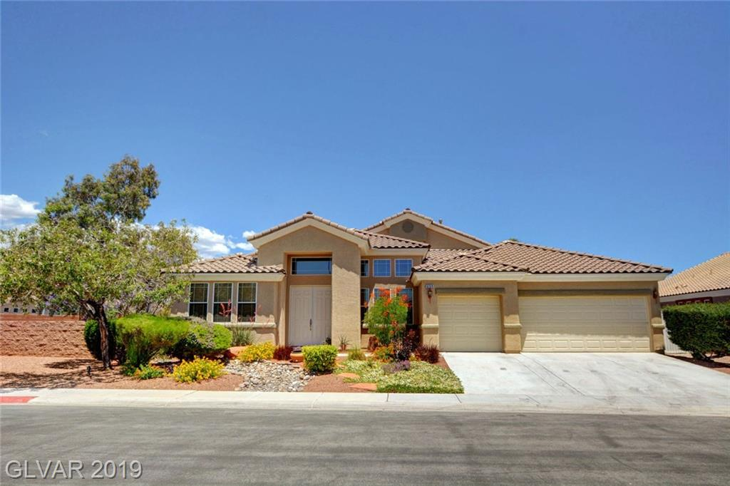 This fabulous single story home sits on a 1/4 acre corner lot! Great gated community in Aliante! The beautiful open kitchen boasts a large breakfast bar, island, granite counter tops, pantry, stainless steel appliances, and plenty of cabinet space! Big laundry room has lots of storage and a sink. Low-maintenance backyard with desert landscaping and covered patio with fan. A MUST-SEE! Come view this fantastic property today!