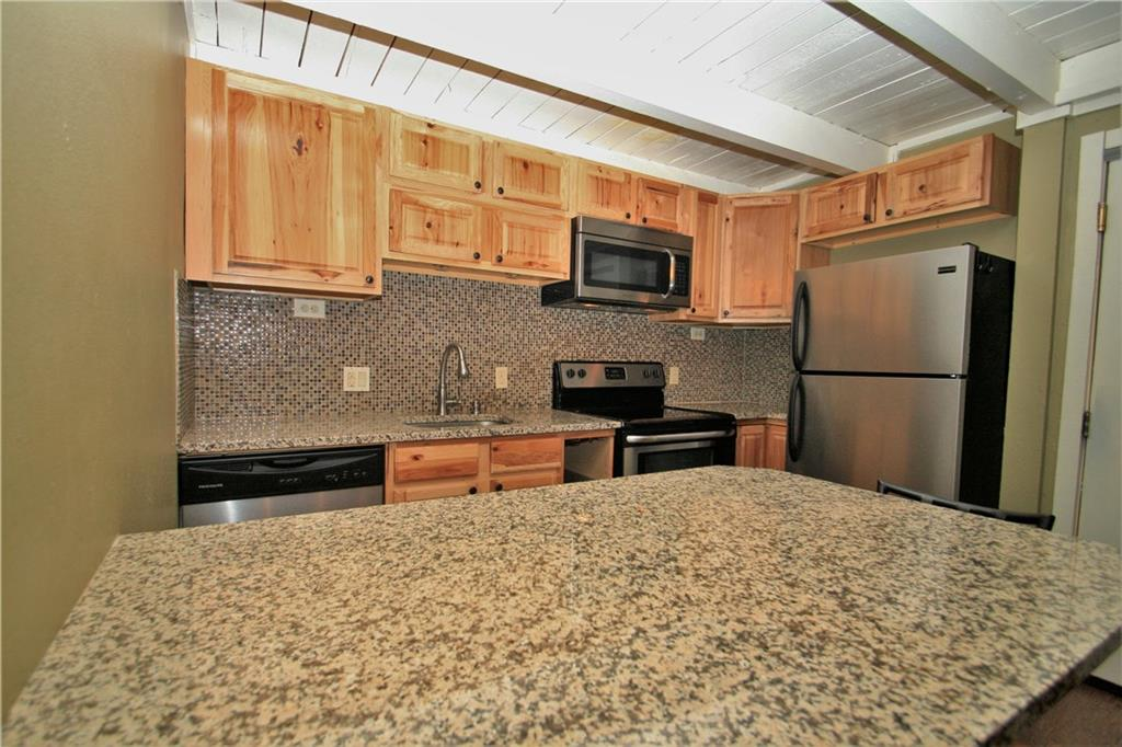 Nicely updated kitchen with hickory cabinets, granite and stainless.