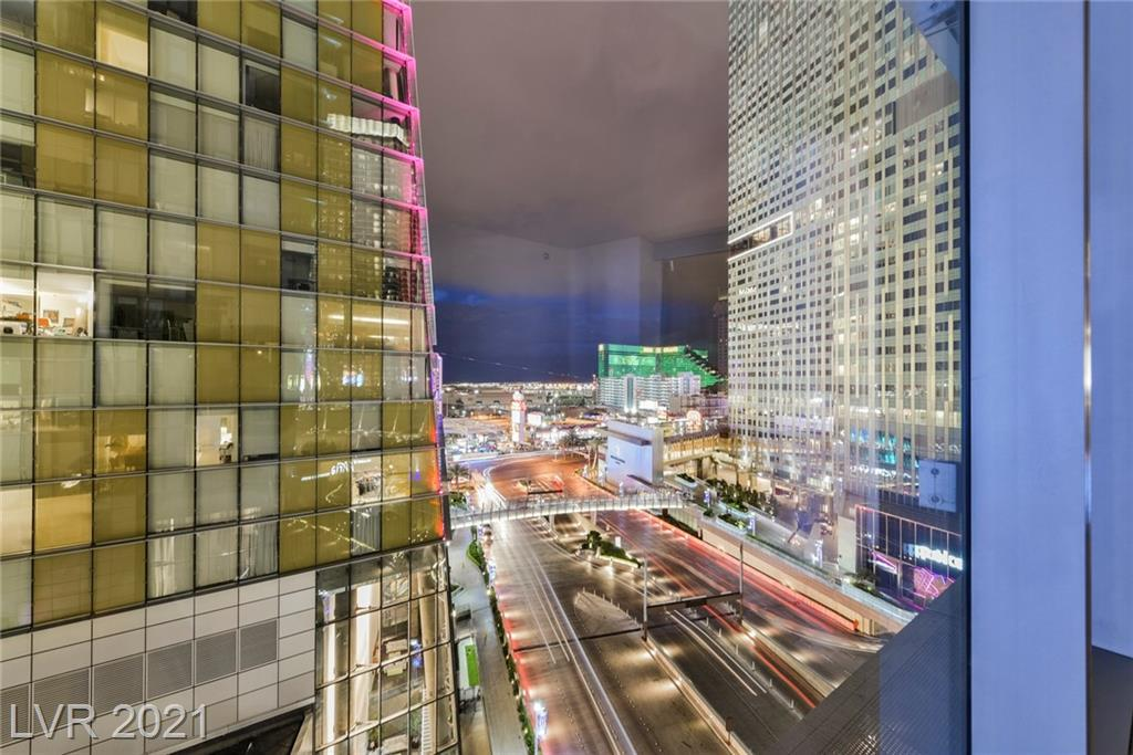 RING THE BELL! CALL LEDELL! LUXURY LIVING in a first-class property! Celebrate the essence of high-style, high-rise living in this beautiful condo at the prestigious Veer Towers at City Center. This beauty features a DYNAMIC CUSTOM LIVING ROOM WALL UNIT WITH MURPHY BED, open floor plan w/ floor to ceiling windows, stainless steel appliances, European style cabinetry and designer flooring. Unequaled views of Las Vegas atop each tower, amenities floor features a roof-top infinity-edge pool, hot tub, sun deck and bar for outdoor entertaining and a recreation room. This floorplan and VIEWS will blow you away!