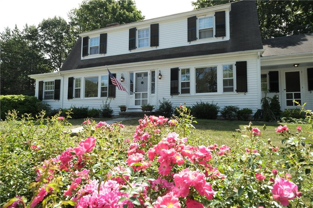 PRICE IMPROVEMENT! If location matters to you, then this is it! Charming gambrel colonial nestled in Country Club Plat offers the convenience of downtown living with the safety and comfort of a cul-de-sac neighborhood. This home sits directly adjacent to the East Bay Bike Path, across from Shaw's Shopping Plaza. A short walk brings you to all of Barrington's amenities including Town Hall, the playground, library, shops and restaurants. Located within Nyatt School district, one of the best public schools in the state! Filled with character, warmth and incredible natural light, this loved home is ready for its new adventure! Please note this home sits high in the Plat - no flood insurance and bone dry basement!