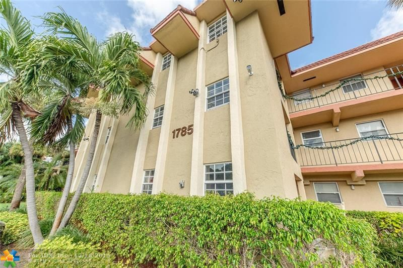 THIS 2/2 CONDO LOOKS OUT OVERLOOKING A CALM WATERWAY AND GORGEOUS LUSH MANGROVES FOR TOTAL PRIVACY.  THE GATED COMMUNITY IS CENTRALLY LOCATED AND MINUTES TO WILTON DRIVE. THE UNIT HAS THE FOLLOWING; TILE THROUGHOUT, SPLIT BEDROOMS, SPACIOUS LIVING/DINING ROOM,WONDERFUL POOL AREA SITTING OUT OVERLOOKING THE WATERWAY AND AN UPDATED GYM AND CLUBHOUSE.