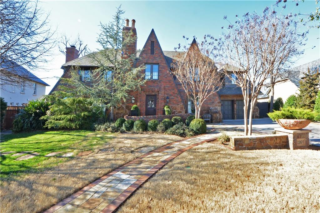 !!!!NEW PRICE!!!!  CURRENT OWNERS SEEKING A BUYER WHO WILL LOVE AND APPRECIATE THIS HOME THE WAY THEY HAVE FOR THE LAST 20 YEARS PLUS!! Classic-but not your typical-1939 Nichols Hills Tudor with many current period updates.  If you like your current Heritage Hills or Crown Heights home but are interested in Nichols Hills, you will LOVE this home. This home features four bedrooms, three full and two half baths and room sizes and closet space not typical of its age.  Many updates cosmetically and functionally.  This is a warm and inviting home that has been meticulously cared for. The exterior landscaping is stunning as you would expect a John Fluitt design to be. Not included in sf is 1,130sf of basement of which 619sf is finished providing a great adult sanctuary or perfect playroom for the kids.  IF you want a white stucco new construction box, this is NOT your house.  But if you want charm, livability, superb construction & timeless style/elegance, this is your perfect new home!!!