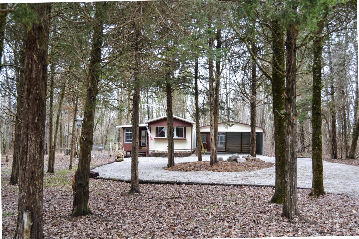 Beautiful wooded setting on 1.58 acres.  Remodeled-move in condition.  14x70 mobile home (980 sf) with stick built addition (384sf partially finished).  The addition has a 17x12 finished room with closet that could be a bedroom or family room. 3 season sun room with lots of windows and carpet.  Gas furnace and hot water heater brand new as well as a new metal roof.   20x12 outbuilding.