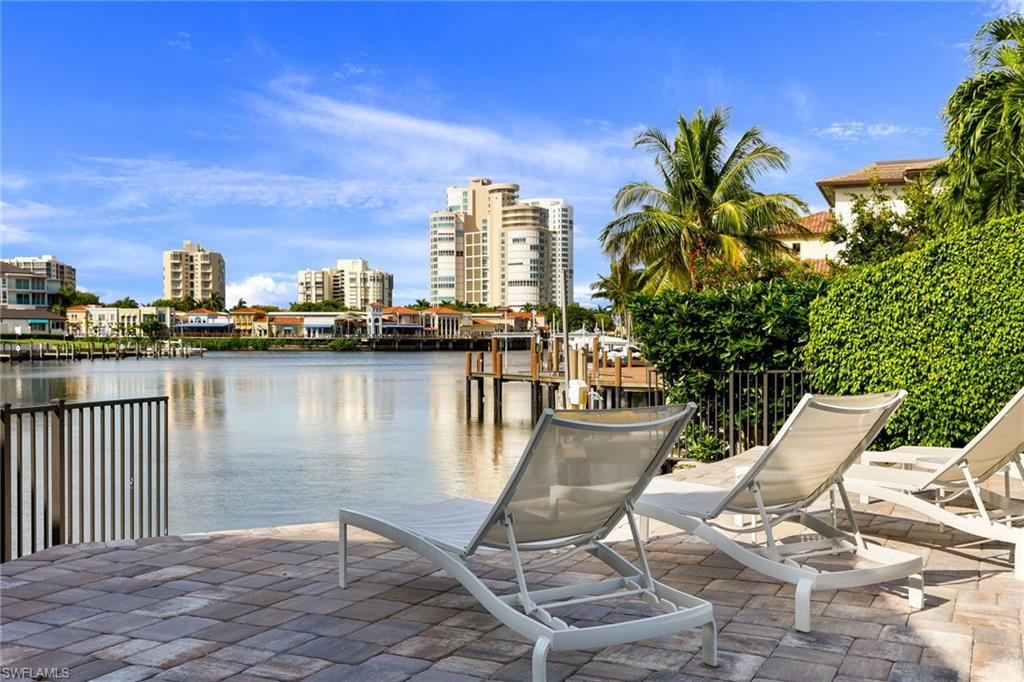 Immaculate unit in the beautiful Naples community of Piedmont on Venetian Bay is move-in ready! The 1,563 square foot residence encompasses 2 bedrooms and 2 full bathrooms and features open concept living allowing for effortless flow from the kitchen, dining, and living rooms to the extra-large glass enclosed lanai that allows indoor and outdoor living to come together seamlessly.  The Piedmont Club offers many amenities including A guest cottage for family and friends, attached covered parking, private extra storage room, outdoor BBQ grill and sparkling pool with bay views! Walk or bicycle to Venetian Village or Park Shore's private beach access. The convenient location is  just a short drive to Waterside Shops or Downtown Old Naples.