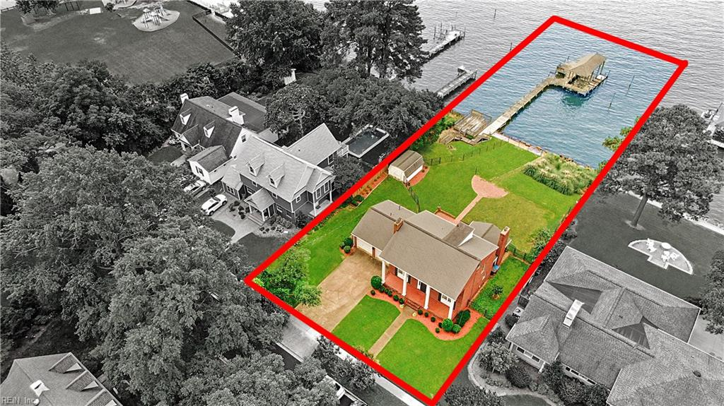 Rare opportunity to own a beautiful Hilton waterfront home! The million dollar views will have you never wanting to leave! Situated on a lot and a half, this home has 90 feet of frontage on the James River! A grandfathered boathouse is a huge bonus! 120' pier with a 16,000lb boat lift, fenced area for dogs to run, brick patio, and spacious screened porch perfect for your morning coffee. Downstairs owners bedroom features unbelievable views of the James! Unfinished walk up attic with tons of potential! Home is solid and is waiting for the perfect new owner to make it their own! Roof, dishwasher, fridge and hvac recently updated. Come see this amazing property!
