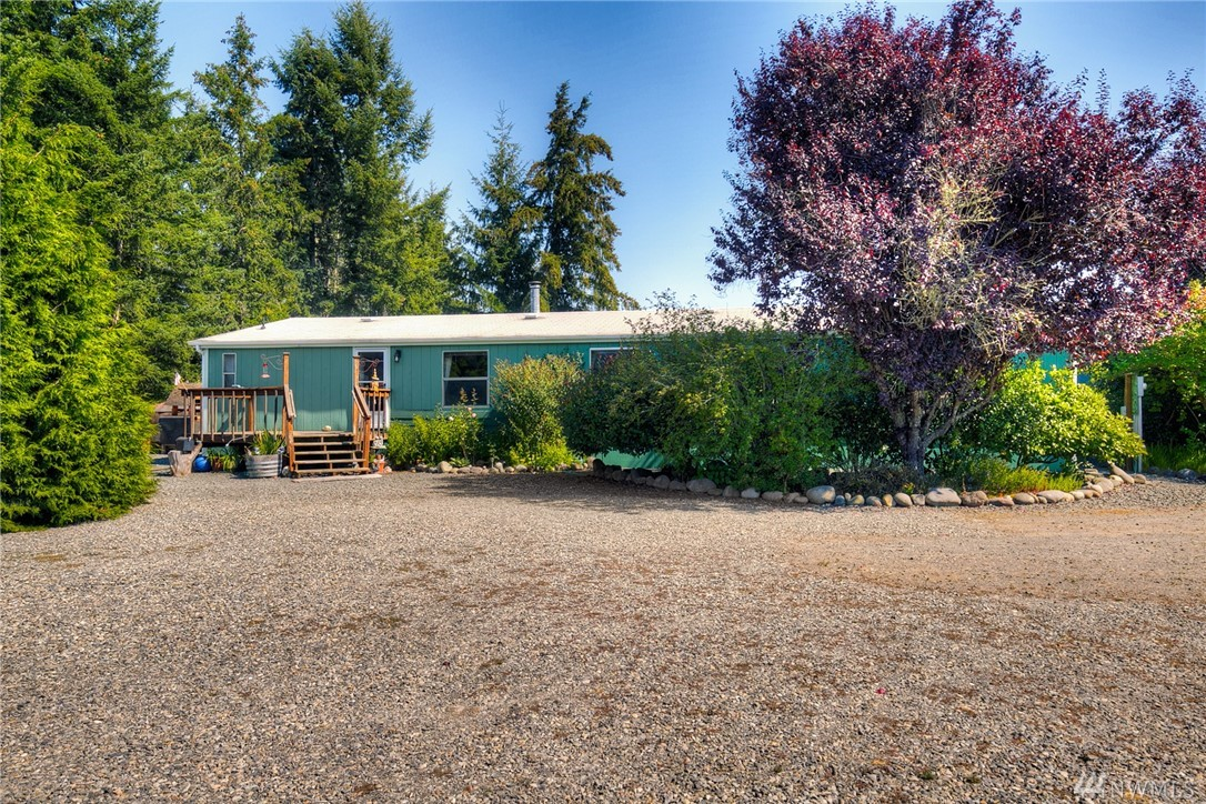 Buyer got cold feet! 20+ acres of serene, secluded farm property with peek-a-boo mountain view! Horse barn w/hay loft, chicken coop, greenhouse and 2 car detached pull through garage with roughed in living space/storage above. Additional storage shed and potential MIL suite. Outdoor fire pit, horse shoe pit and firing range with backstop. Tall firs surround pasture that offer shade for horses. 4 bedroom septic, 2 full bath with wood burning fireplace. High efficient heat pump and close to JBLM!