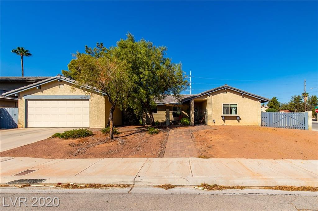 Wonderful updated home set on a premium corner lot with double RV parking. You will fall in love with the rear yard sanctuary that promotes a peaceful setting. Convenient location near the fabulous Las Vegas Strip, UNLV, T-Mobile Arena, Raiders Stadium, as well as world class entertainment, dining, and shopping. Beautiful curb appeal enhanced with a paver stone walkway and custom iron work leading to a gated courtyard. Living room treated to a patio slider and two solar tubes allowing natural to pour in. Family room is highlighted by a brick fireplace, patio access, and a solar tube. European influenced kitchen is complete with granite, quality maple cabinetry with pullouts, and high-end GE appliances. Tasteful decor throughout this lovely home includes stone pattern tile, cork floors, granite, ceiling fans, and stylish commercial window shades. Convenience features such as updated dual pane Low-E windows, Ring doorbell, and extensive updates make life easier.