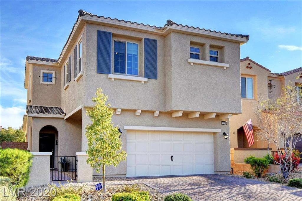 Fabulous three bedroom home in a gated community in sought-after Skye Canyon! Awesome paver stone driveway!