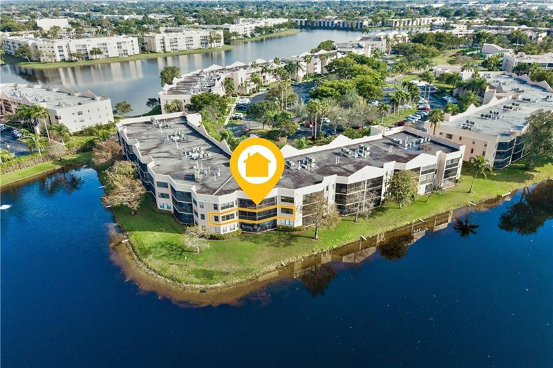 Stunning Kings Point condo just hit the market in Tamarac!! This beautiful home features 3 bedrooms, 2 bathrooms and 1,865 sq ft of living space, with a breathtaking view of the lake, lots of storage & guest parking. The kitchen comes equipped with granite countertops, ample pantry & cabinet space, & breakfast bar. This stylish home also boasts newly renovated bathrooms and in-unit laundry. During summer, entertain in style in the screened-in balcony overlooking the lake, or relax near the community pool. This community also comes equipped with  tennis/shuffleboard courts, fitness, and courtesy shuttle. Located in the H building, in the highly coveted Fairfax. Check out virtual doll house tour & video! LOW DOWN PAYMENT ACCEPTED!