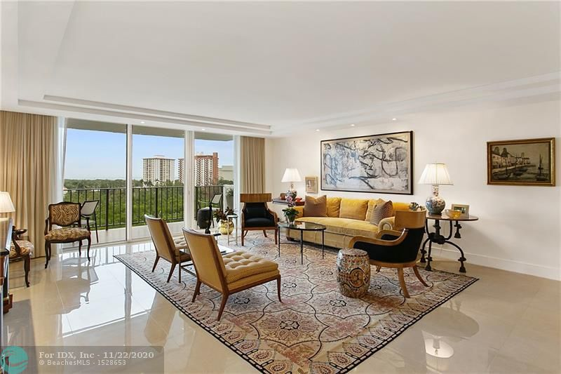 """This spacious condo has been completely renovated within the last year and has Intracoastal Waterway, Bonnet House Museum & Gardens, and ocean views from every room. The modern, neutral interior design and architecture was professionally conceived and will provide a beautiful backdrop for your furnishings. Upgrades include Italian porcelain 24""""x24"""" tile floors, skim coated ceilings, impact windows and doors, custom wood cabinetry in the kitchen and bathrooms, granite counters, Bosch appliances, LED lighting, and custom fitted closets. Top of the line fixtures and hardware were used throughout the unit, from Lutron dimmers to Santec fixtures. There is also a new hot water heater and ductwork, pet friendly (up to 50lbs), 24/7 security, dockage (up to 35'), 1 assigned parking space."""