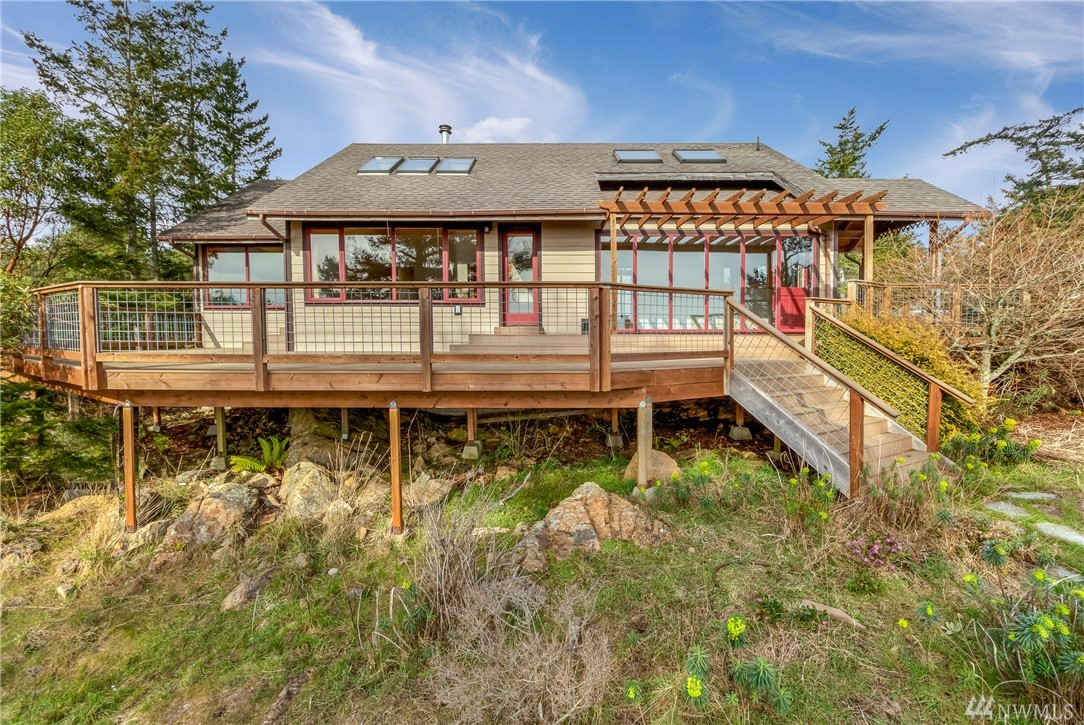 This 2 bedroom , 2 bath home is drenched in sunlight with views of the Olympic Mountains, Haro Strait,  Lopez Island and beyond. Bonus room, great deck, fenced garden area, 1 car attached garage, community water and a nice storage building.
