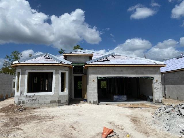 NEW CONSTRUCTION: Bonita National is the #1 Selling Community in SWFL 3 years in a row. Amenities include Clubhouse with Formal/Casual Dining, Beach Entry Resort Pool, Fitness & Aerobics Centers, Poolside Café Bar & Grill, 8 Tennis courts, 18 hole Championship golf (select homesites), Full Service Spa, social clubs & fitness classes.  The Angelina is a perfect size home with an open concept floorplan and 2 car garage. White Shaker cabinets, plank tile throughout and wood in the den, upgraded paint, granite countertops, stainless steel appliances, wood shelving in closets, blinds, smart home and hurricane impact windows & doors. Beautiful water views complete with outdoor kitchen, wood ceiling lanai, pool and spa! Social membership included. Full builder warranty.  . Virtual tour and additional pictures are of like kind model & is used for display purposes only. This home is under construction for an estimated completion date of Nov/Dec 2020.