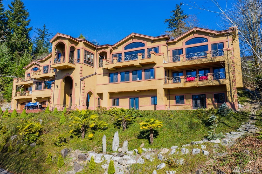 Private 3-story 5 bed, 6.5 baths w/ a panoramic views of Seattle, LK WA, Puget Sound & Olympics from patios/deck and oversized windows. 2 steam rooms, 1 sauna, 2 jetted tubs. Majestic home has 7950 sq ft of grand scale rooms, high ceilings, 3-story elevator, A/C, radiant & forced air heat; overhead speakers and surround sound in the whole home. Wood beam box ceilings, marble, granite, laminate, & bamboo with radiating heated floors throughout.
