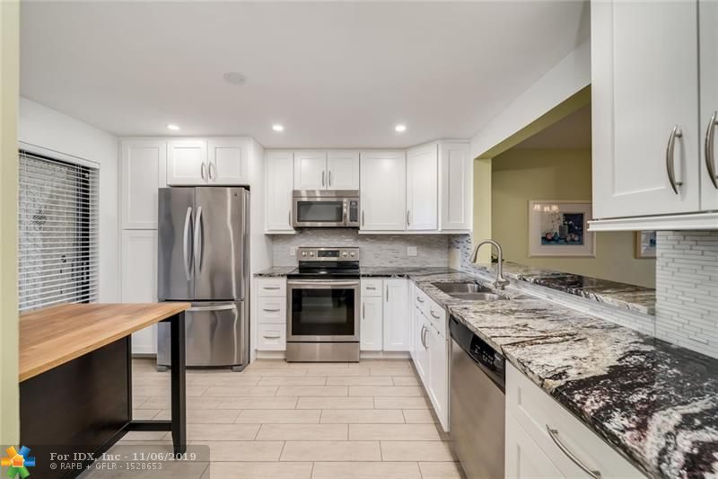 NEW GORGEOUS RENOVATIONS in exclusive 55+ golf course community. This rarely available end unit is HUGE - 2/2 with den (easily converted to 3rd bedroom) has TWO SEPARATE SCREENED BALCONIES W/BEAUTIFUL LAKE, POOL & GOLF COURSE VIEWS! Convenient in-unit washer & dryer (3 years old).  Stainless appliances (3 years old).  A/C unit & water heater both 2 years old.  Balcony storm shutters plus some impact windows.  Walk-in closets.  Heated pool and Barbecue area on-site.   Ownership includes membership in Lakes of Environ Cultural Center offering activities, tennis courts, pools, exercise room, etc.  This Unit is a MUST SEE.  Association approval required - 650+ credit score required  Furniture & Furnishings are negotiable.  Drapes not included in sale.  FIRPTA affidavit required at closing.