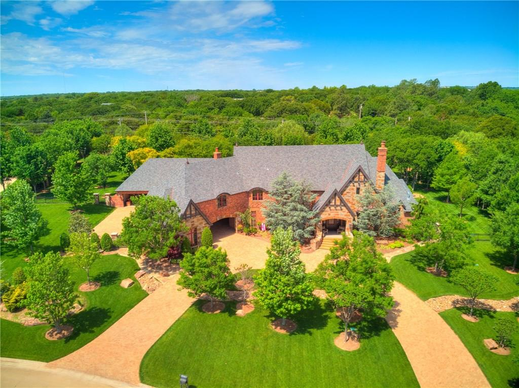 Confession time:  I am secretly in love with this one! Sophisticated and luxurious retreat that reflects that magical merging of inspiration and architecture *Meticulously detailed, to say the least*Superb location within minutes away from dining, and shopping*Circle drive with a grand entrance*Opulent study designed for a boss*her study*Dramatic 2 story fireplace in formal living*Elegant formal dining covered in grass cloth wallpaper*Tremendous chef's kitchen designed to host a party*Family/living with the most seductive fireplace*Only a dream describes the Master Suite presented for a Queen*His and her closets, toilets and countertops*Copper soaking tub*Double staircase explains the voluminous layout*3 dedicated bedrooms and bathrooms upper level*Gameroom upper level*Resort like backyard*Extended covered patio with an outdoor kitchen, half bath, and fireplace*Free form shaped pool with a gas heater*Rolling, green lawn perfectly designed between the ample amount of grown trees*