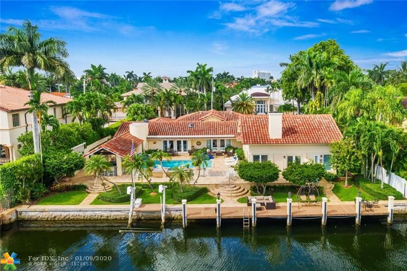 Superbly located on one of Harbor Beach's most desirable Isles with rare 120 ft of deepwater with approx 11ft depth, 135ft wide canal & 18,000sf property. Immaculately presented on one level with a great balance of formal & casual entertaining areas.Impact glass & 2011 new roof.Kitchen is open to expansive great room, formal areas include elegant dining & living rooms plus library/den. Varying ceiling heights add interest & character.The Master Suite is approx 1,200 sf, vaulted ceilings, great closets & spa style bathroom plus pool & views! Floorplan allows privacy to the other well sized bedroom. Outdoor entertaining is a huge focus with covered gazebo bar & dining plus Summer Kitchen & oversized pool. Beach lovers enjoy the private Surf Club & additional boats may be docked at the Marina