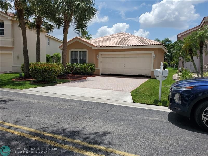 RARELY AVAILABLE,BEAUTFUL SINGLE FAMILY HOME LOCATED IN THE ENCLAVE, A GATED COMMUNITY IN THE WYNDHAM LAKES COMMUNITY. FEATURES INCLUDE WOOD LAMINATE THROUGHOUT EXCEPT MASTER BEDROOM. UPDATED BATHS, WALK-IN CLOSETS, NEWER REFRIGERATOR,MICROWAVE AND DISHWASHER, VAULTED CEILINGS, VERY LARGE SCREENED PATIO OVERLOOKING A SERENE CANAL, ALL AGES COMMUNITY, A+ SCHOOLS. DESIRABLE CORAL SPRINGS. DON'T PASS THIS UP. BEING SOLD AS-IS. EASY TO SHOW ****DON'T LET THE CATS OUT***