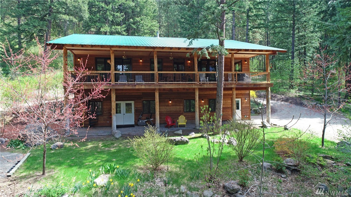 Charming custom home adjacent National Forest offers peaceful mountain serenity. Hike right out the door! Lg windows connects w tranquil setting. Chef's kitchen w gorgeous stone counters, sociable cooking island, hi-end appliances & walk-in pantry. Impressive river rock fireplace creates cozy ambiance. Deluxe master bdrm w walk-in closet, ensuite tiled bathroom, fireplace & office nook. 2nd bdrm &bath. Practical 3 car carport & covered entry.  Insulated basement shop, office, garage & storage.