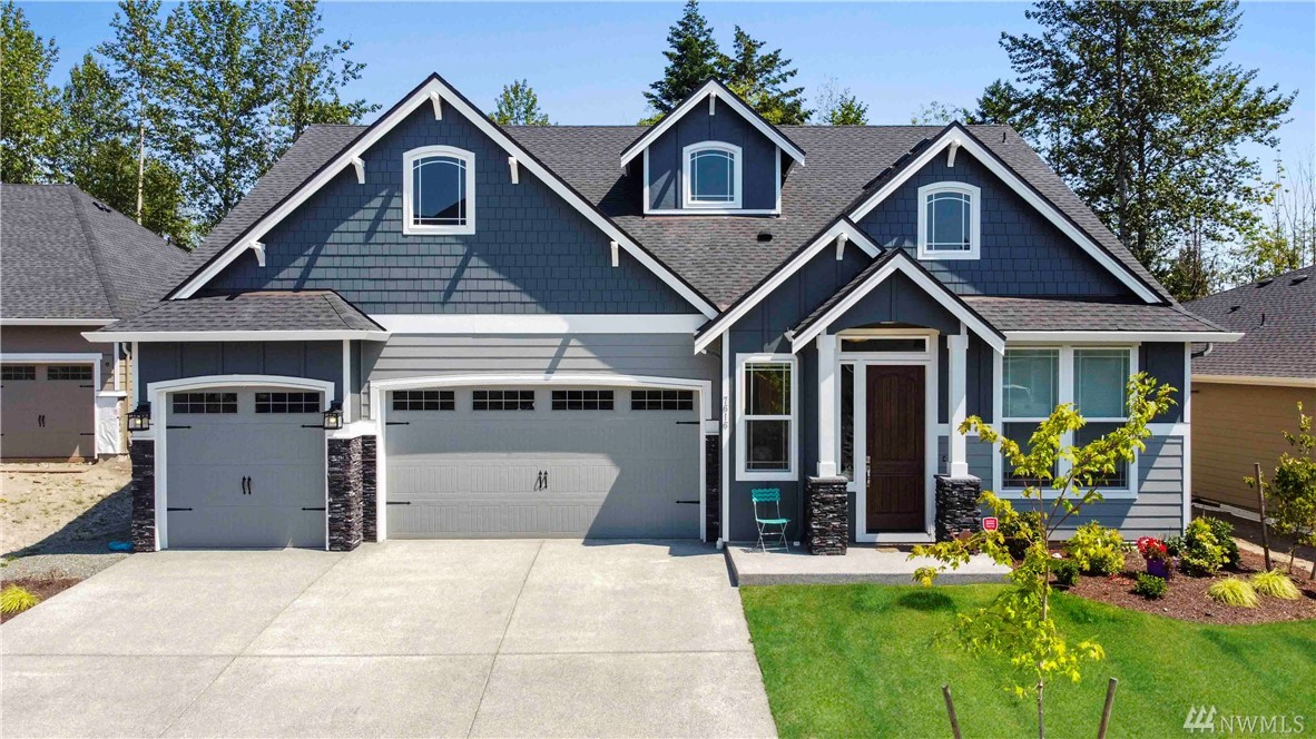 """Better than New! This magnificent 2930 sq ft home has been fully equipped w/over $100k in custom, high end, upgrades! Grand entrance w/10 ft ceilings/8 ft doors, modern """"Chef's Kitchen"""", top of line appliances, double oven, butler's pantry, dining room, den & master bdrm w/walk-in shower all on main floor. Thoughtfully designed custom cabinetry throughout home, A/C, covered Patio w/FP, generous loft space (wired for theater) This layout lends itself perfectly for dual """"Work at Home"""" stations!"""