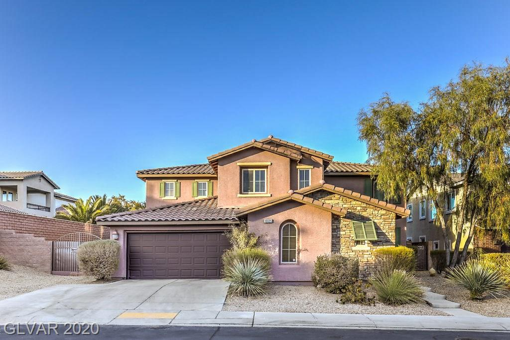 Stunning upgraded home in Mountain's Edge gated community! Open floor plan features vaulted ceilings with gorgeous staircase, large kitchen with white marble countertops & waterfall island, wood & stained concrete flooring throughout downstairs, and master bedroom with walk-in closet. Resort-like backyard with pool/spa and multiple waterfalls, and large side yard with RV parking.