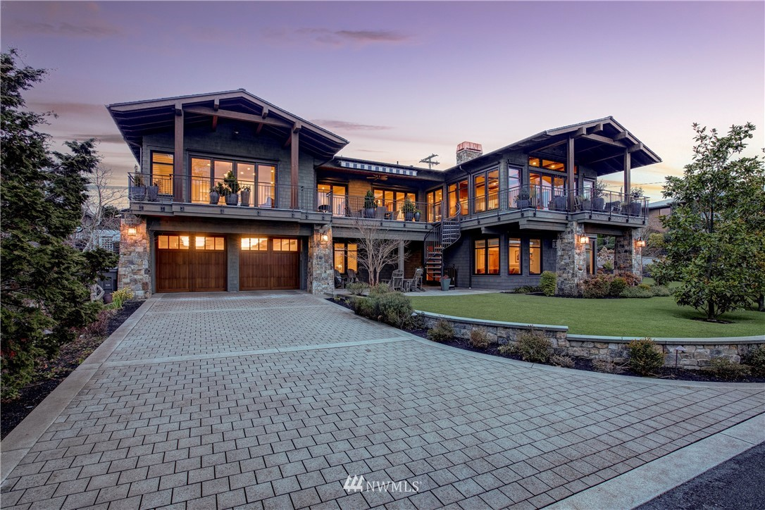 This stunning 4 bedroom/ 4 1/4 bath Lake Washington & Mountain view home sits on a large corner lot in the desirable West of Market neighborhood just blocks from downtown Kirkland. Built in 2015 as a forever home by luxury homebuilder, Casady Homes, this homage to Craftsman architecture & workmanship is an impressive display of style & function. The soaring ceilings and walls of windows bask the large functional floor-plan in south and west facing light and tranquility while the extensive outdoor decks and patios provide unparalleled outdoor living spaces perfect for entertaining. Interior features include: 2 Master Bedrooms on either level, 3 separate living areas, 4 car double-tandem garage, gourmet kitchen with butlers pantry and more.