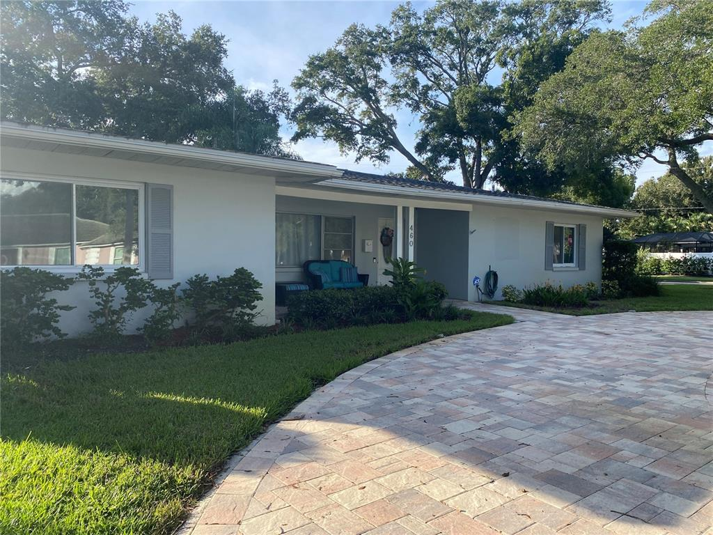 Beautiful, renovated 3 bedroom, 2 bath, 2 car garage in the heart of  Belleair.  You can see the Clearwater Bay from the driveway which is only 2 blocks away. Home has new wood floors and baseboard, new insulation, 2021 AC system, new interior solid wood doors and newly renovated bathrooms. Just a short walk to the bluff is a great community park where you can pull up a chair to watch the sunset with the neighbors or take your dog on a nice walk with a scenery. The home has a pool and spa with an enclosed screen enclosure surrounded by a 6 foot vinyl privacy fence.  There is a circular paved driveway in the front and another paved driveway to the 2 car garage. Two  golf courses close by, Belleair Country Club and the newly renovated Pelican Country Club. Beaches and fine restaurants are 5 minutes away.
