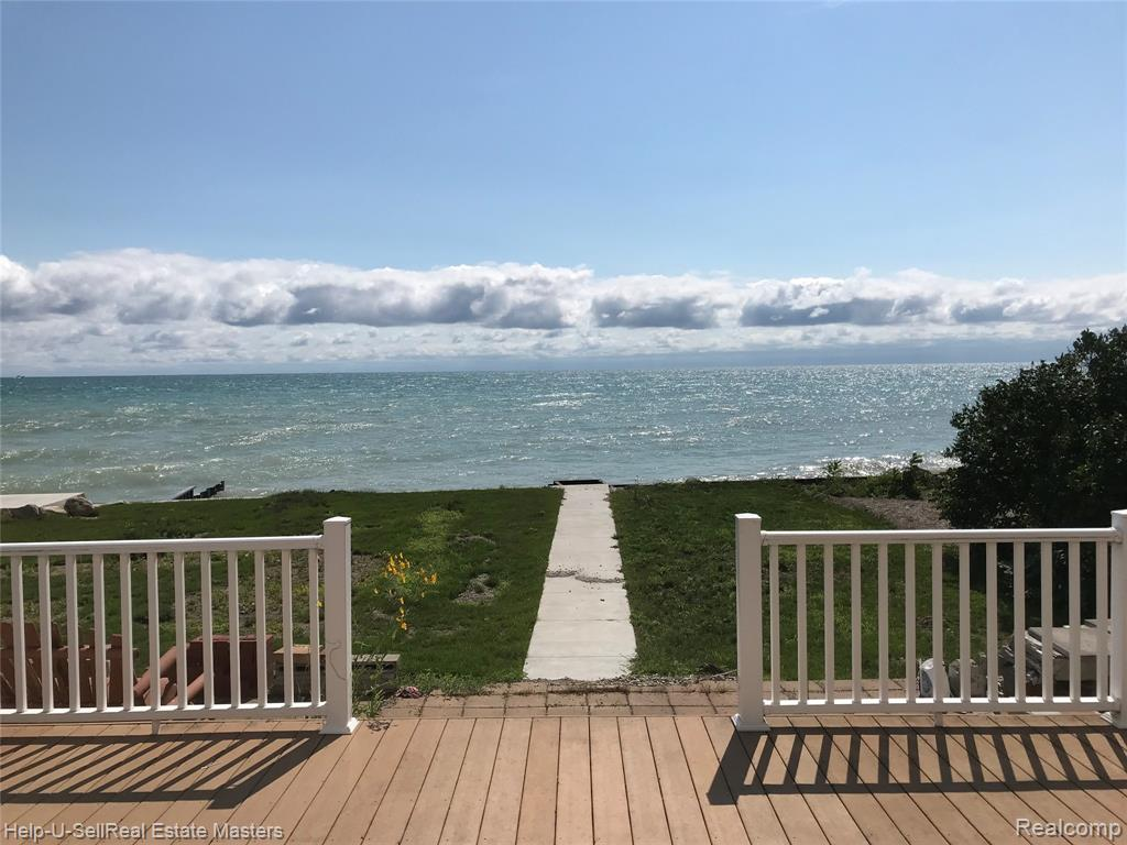 52 feet on lake Huron. Sea wall and a beach!  Surrounded by very nice homes and  sets well off the road. City water ,Large garage. This could be enjoyed as a year round home or as a second home. Short walk to township parks, boat launch and the Tally Ho.