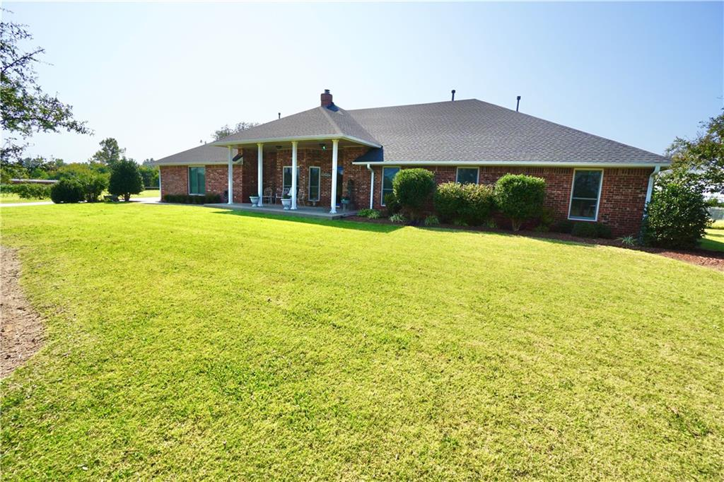 Beautiful brick home on over 2 acres in Moore w/ 30x40 brick shop with overhead doors.  Home has 4 bedrooms, 3 full baths, 3 car garage w/ storm shelter, theatre room w/ all the amenities included (recliners, projector, screen, surround sound), sunroom overlooking waterfalls and pond w/ fish.  Updated kitchen w granite, island, walk-in pantry off the utility room, double ovens, microwave, dishwasher, fountain coke machine tucked away. HUGE dining room.  Master bedroom w/ 2 walk in closets, double vanities, tub, and separate garden tub.  Zoned HVAC and H2O tanks.   All windows have been replaced w/ Anderson top-of-the-line Windows.  Home is on a lot that is very wide (no close neighbors).