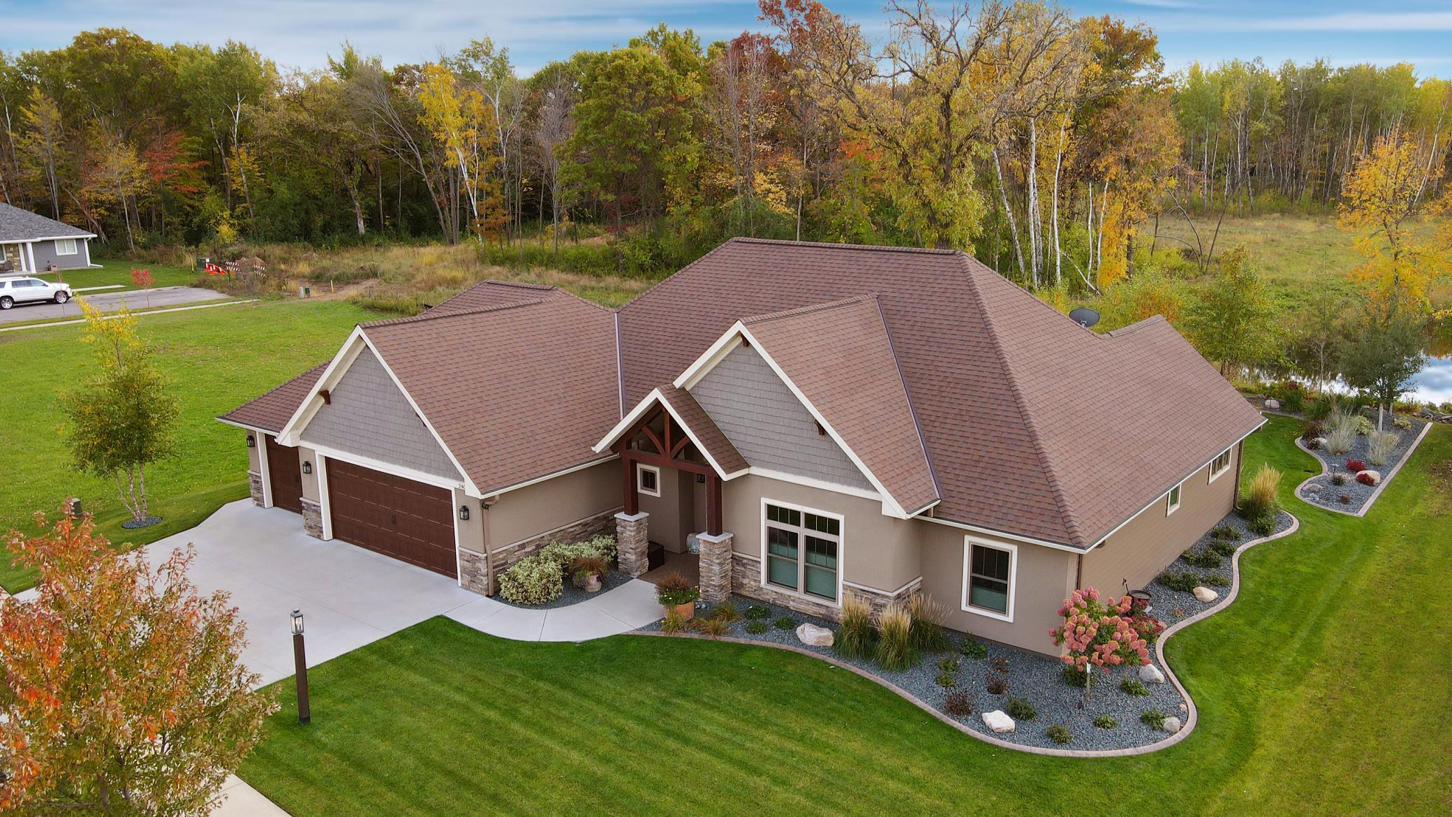 Stunning custom patio home in South St. Cloud's beautiful Quarry Woods.  Every room in this 3 bed 3 bath home is immersed in luxurious details.  Home equipped with Control4 Whole Home automation system that allows you countless ways to make your life easier.  This home is a masterpiece of design and craftsmanship featuring polished concrete floors w/in floor heat.  Knotty alder cabinets & woodwork throughout. Accented ceilings, spacious kitchen boasting 6 burner gas stove, large island, granite counter tops & huge walk in pantry.  The exquisite outdoor landscaping creates your own private oasis with two separate patio areas with retractable awnings, built in gas fire pit and meticulously manicured yard.  4 stall heated garage highlights include textured flooring, tons of cabinet storage including attic & overhead walk out screen door.  With all this and so much more to offer you must see in person!