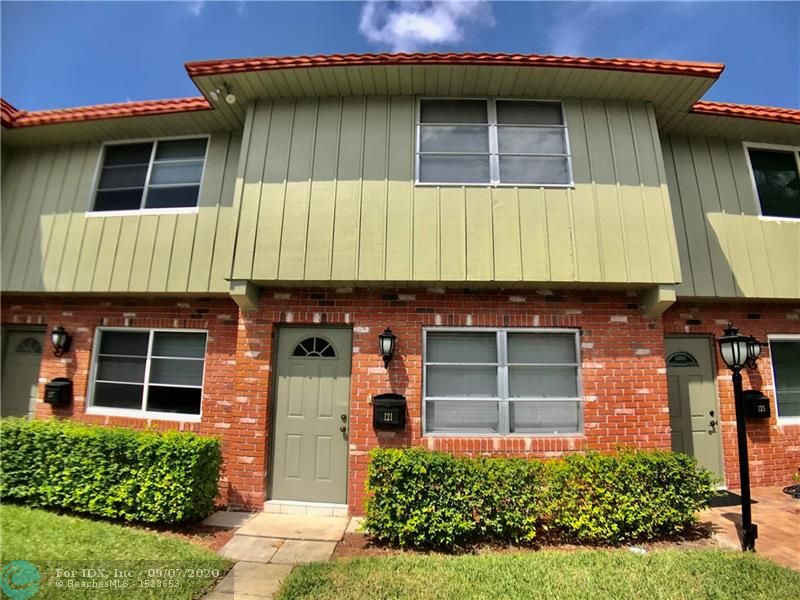 Well-kept Manor Grove townhome in the center of Wilton Manors. Move right in. Most furnishings included in sale. Ceramic tile floors on lower level and new carpeting (1 year) on upper level.  Freshly and tastefully painted throughout (1 year) with smooth ceilings. Full washer and dryer. New impact sliding door opens up to the very private, fully fenced back yard perfect for grilling and relaxing. Pets allowed - up to 2 dogs. Community swimming pool and clubhouse. Convenient to everything Wilton Manors has to offer.  Assigned parking right in front of your door.