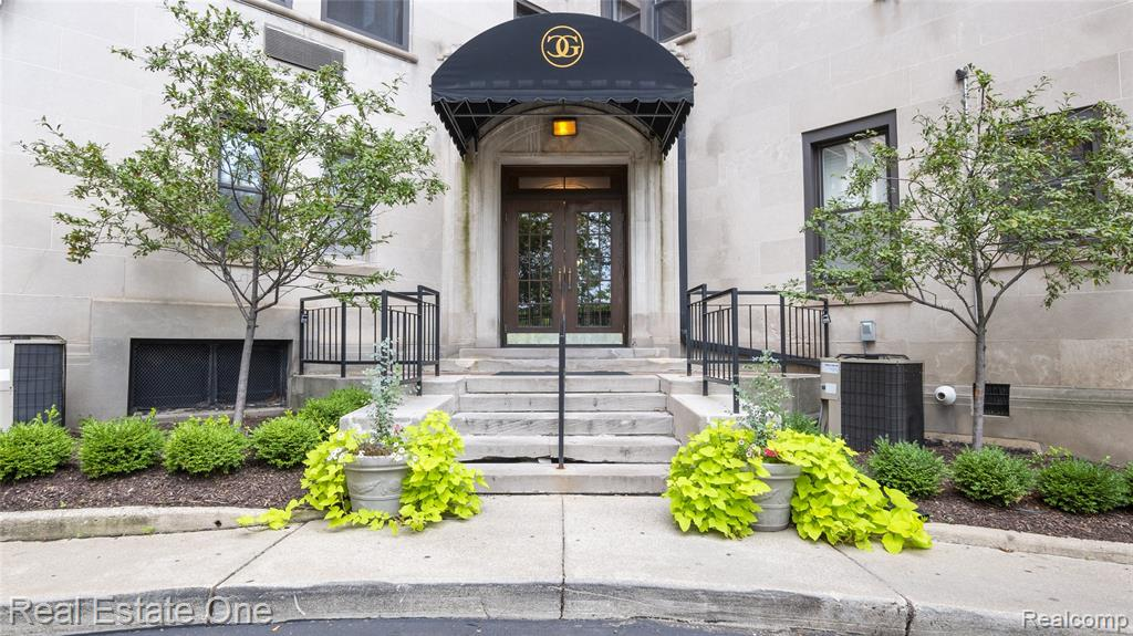 Unique opportunity to renovate a large condo residence within steps of Detroit's riverwalk and waterfront community. Experience this remastered floorpan to create large expansive pantry plus large master suite with large walk-in closet and on-suite bath. Buyer can come in and make the cosmetic updates to make this a great space UNDER VALUE! Hardwood floors have been sanded ready for you to finish as you wish.  Painted neutral throughout to keep the feel fresh so you can imagine the possibilities.  Kitchen has lots of storage space and ready for you to customize. NEZ-Rehab in effect- offering approx. a 75% reduction on property taxes. Sale includes 1 garage space and 1 gated outdoor parking space. The community is surrounded by strong retail, businesses, and restaurants. A short walk or bike ride to the Riverwalk, minutes from downtown, and close to local grocery.