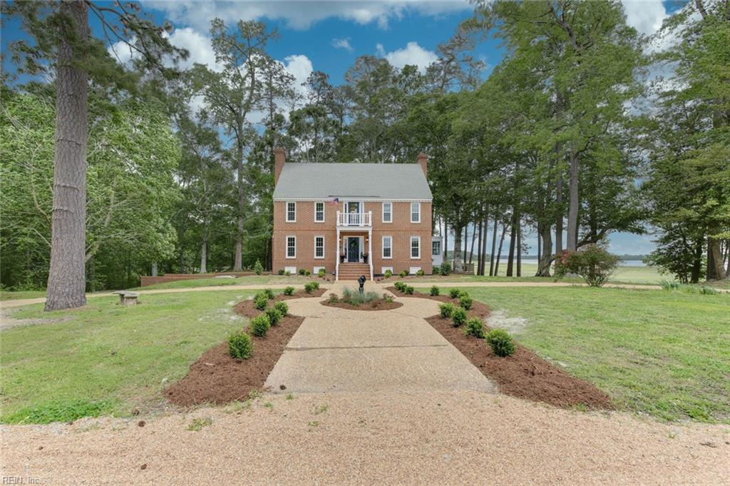 This is a Southern Estate Y'all!  It is beautifully remodeled. Gleaming hardwood floors and a breathtaking view of the Nansemond River, all on 10.7 acres. Enjoy the benefits of privacy but located within a neighborhood. Crown, chair rail, and baseboard moldings add to the elegance of this home. Extra storage with multiple cedar closets. The main house has a finished basement/garage/workshop area, heated and cooled approx. 1150 sq. ft. The guest house, not included in the main square footage, is approx. 990 sq ft. featuring two bedrooms, 1.5 bathrooms, a sitting/den area, and barn storage.