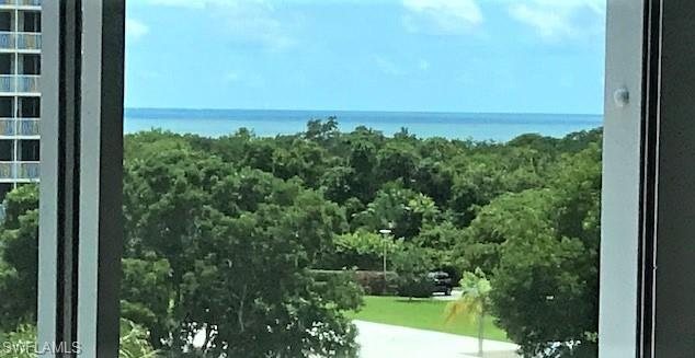 Beach, Bay, Boating, Tennis & so much more! Steps from the beautiful sand & surf of Vanderbilt Beach and Delnor Wiggins State Park. This 4th floor corner residence offers Bay & Gulf views. Loaded with natural light, guest BR has it's own private lanai. Boaters, kayak enthusiasts, joggers and beach combers will fall in love with the location! Perfect for the beach loving family, grab a towel & a chair and you are there. Large 2 B/R & 2 Full Baths, Ready for immediate occupancy or rentals as it's being offered Furnished. For peace of mind, electric hurricane shutters throughout.  Liberal rental policy and a separate storage room for beach toys, golf clubs, luggage, etc. Potential to lease a Boat slip (as available) at the private marina with no bridges to Wiggins Pass and the Gulf. Opportunity Knocks!