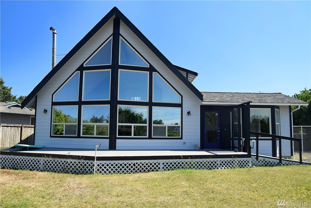 Awesome waterfront home on two lots located in one of the best locations in Ocean Shores. This property is a great investment with 120 feet of waterfront and has a dock installed. This beautiful home is close to the ocean beaches and built extremely well. House has been recently remodeled and updated so everything is fresh and clean. Enjoy giant vaulted ceilings, big windows facing the water, fully fenced sideyard, and plenty of space to enjoy your new life.